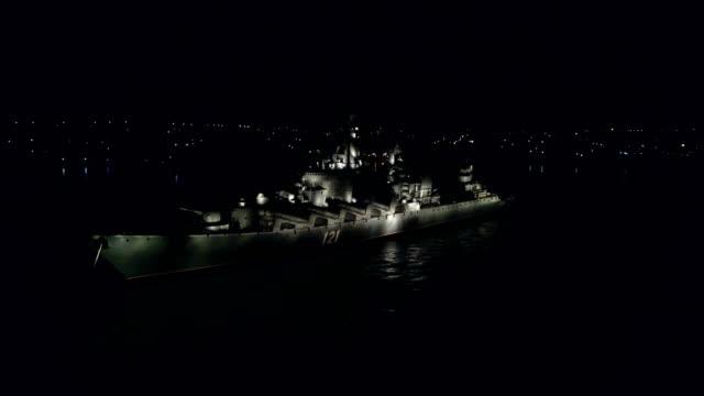 Bидео Aerial View - warship with night illumination