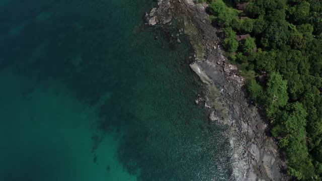 Aerial view white sand beach turquoise sea water 4k
