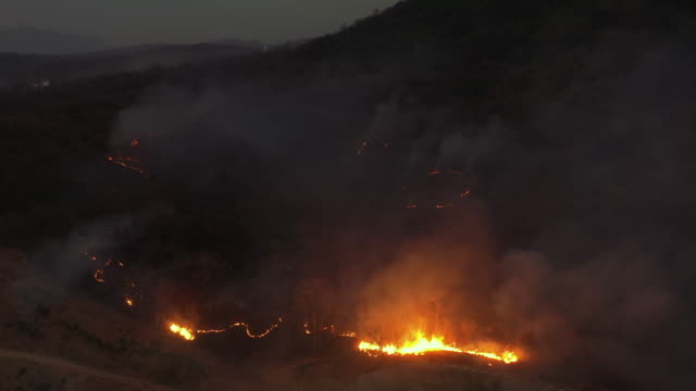 Aerial view wildfire in night time 4k aerial view real time of wildfire in night time. Air pollution and environmental issues. australia stock videos & royalty-free footage