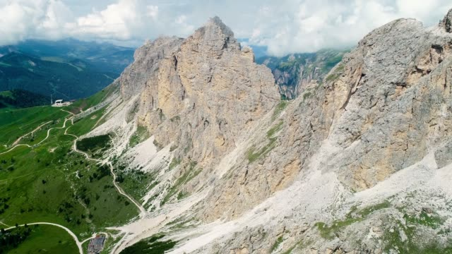 Aerial view with a drone of mountain with green forest in the valley in Italy. Beautiful landscape in a natural park 4K