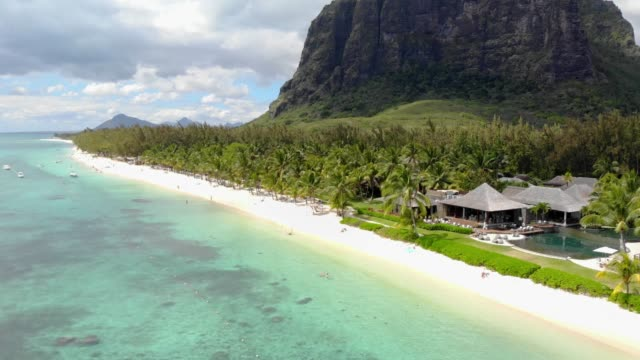 aerial view with beach and le morne mountain in mauritius. tropical lagoon - isole mauritius video stock e b–roll