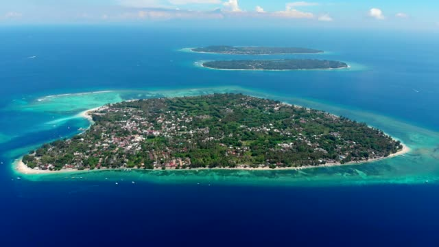 Aerial view with Gili islands and blue ocean.