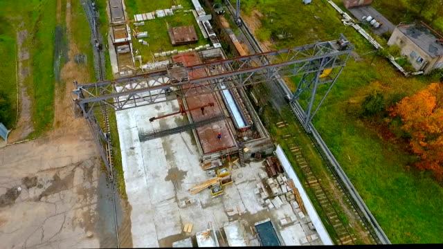 Aerial view working industrial crane. Industrial crane loads cargo video