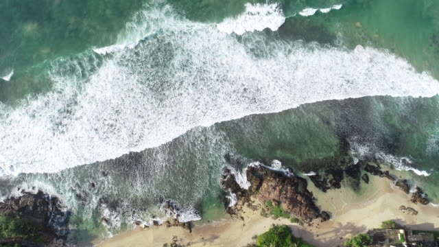Aerial view.Drone ascent aerial footage of ocean waves and sandy beach landscape