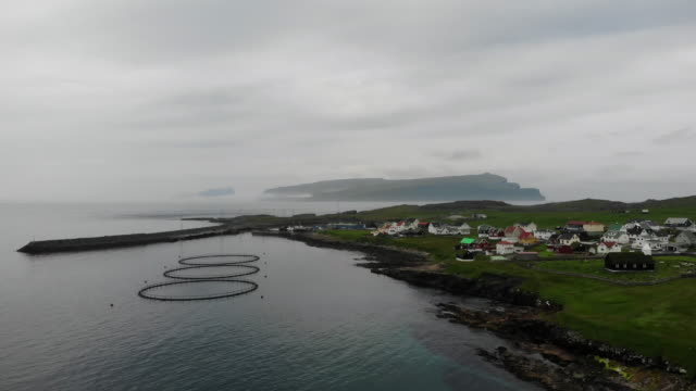 Aerial viewof the town in the Faroe Islands, a territory of Denmark in the Atlantic Ocean. Salmon production.