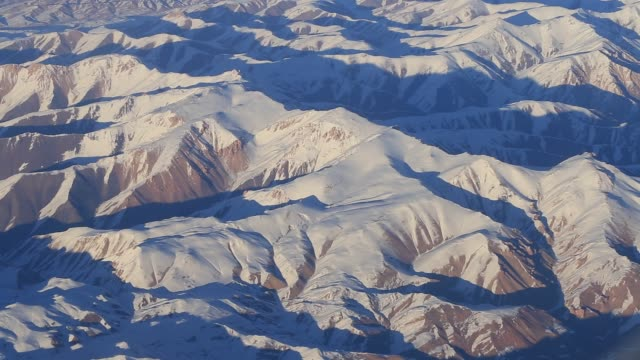 Aerial views in mountain. View from the plane window. The Hindu Kush mountain system in Afghanistan video