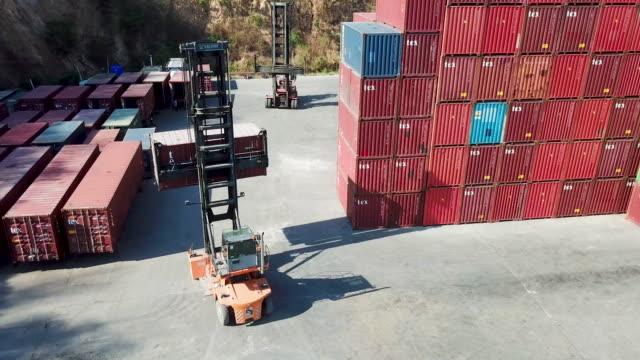 aerial view.shipping container loader truck transporting box. - port wine stock videos & royalty-free footage