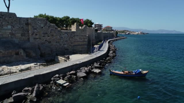 Aerial view/Turkish Flag and City Walls.The place called 'Beskapilar' /Foca,Izmir. Izmir/Foca 09/19/2018 Aerial view/Turkish Flag and City Walls.The place called 'Beskapilar' /Foca,Izmir. Izmir/Foca 09/19/2018 general view stock videos & royalty-free footage