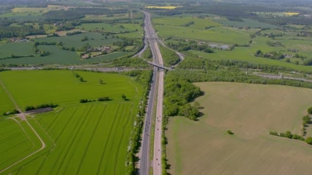 aerial wide view of a motorway junction m25 m40, uk. 4k - inghilterra sud orientale video stock e b–roll