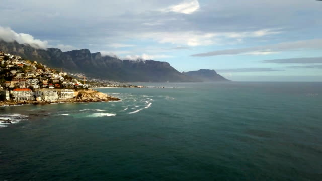 Aerial Wide View Of Cape Town South Africa's Coastline With Table Mountain Aerial view of Cape Town South Africa's coastline with Table Mountain behind it. cape peninsula stock videos & royalty-free footage