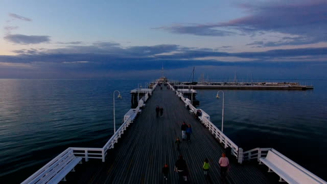 Aerial: Wooden pier in Sopot, Poland Aerial, Sopot, Poland, pier, dusk, unrecognizable people, summer, sea gdansk stock videos & royalty-free footage