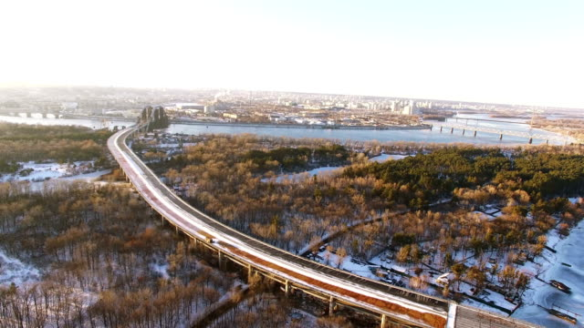 4K Aerial.Abandoned highway in city winter suburb. Urban landscape, lateral flight