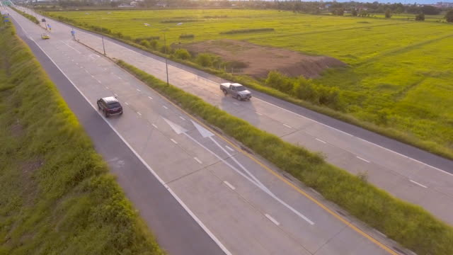 Aerial:Black SUV along the road video