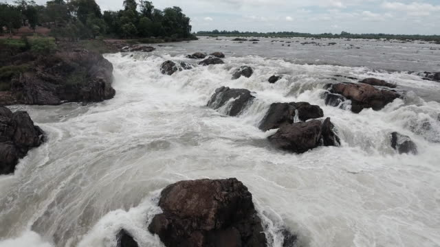 aerial:low fly back over series of cascading waterfalls and rapids in the Mekong river aerial : low fly back over series of cascading waterfalls and rapids in the Mekong river back to back stock videos & royalty-free footage