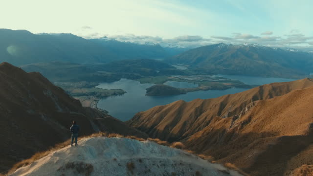 aerial:man at top mountain - in cima video stock e b–roll