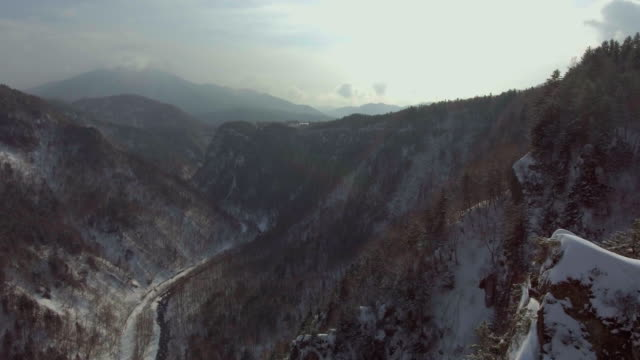 Aerial:Snow fall and Mountain peak video