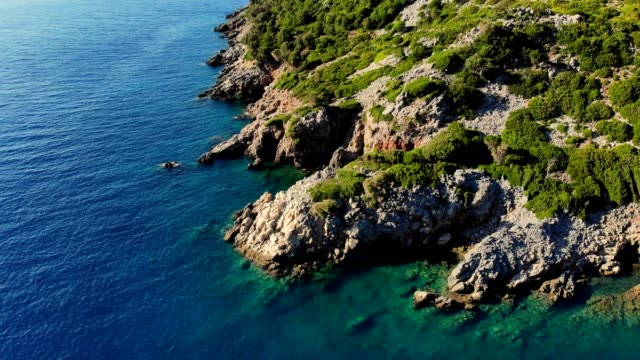 aero. view from above. beautiful summer seascape. Rocky beaches of Evia island, Greece. sea turquoise, blue water at the foot of the cliffs, among the mountains video