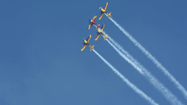 Aerobatic planes do barrel roll in formation flying video