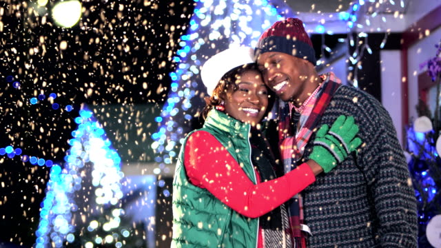 Affectionate African-American couple at winter festival