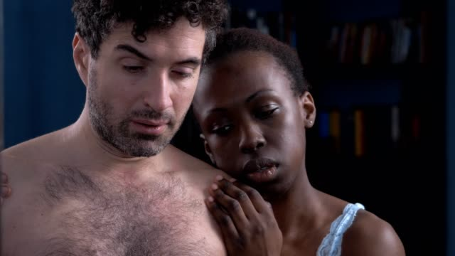 affectionate black woman comforting is husband at mirror who lost job - sostegno emotivo video stock e b–roll