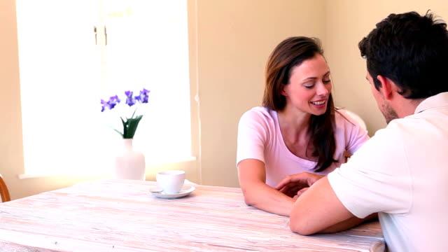 affectionate couple chatting at the table - 30 39 år bildbanksvideor och videomaterial från bakom kulisserna