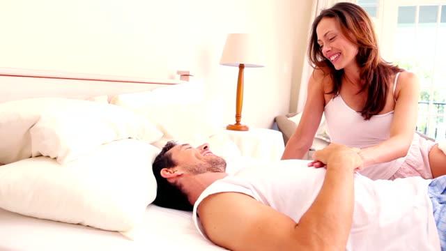 affectionate couple lying on bed together - 30 39 år bildbanksvideor och videomaterial från bakom kulisserna