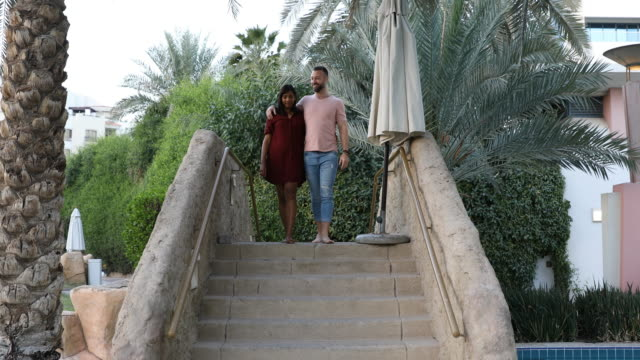 Affectionate couple relaxing in their resort garden