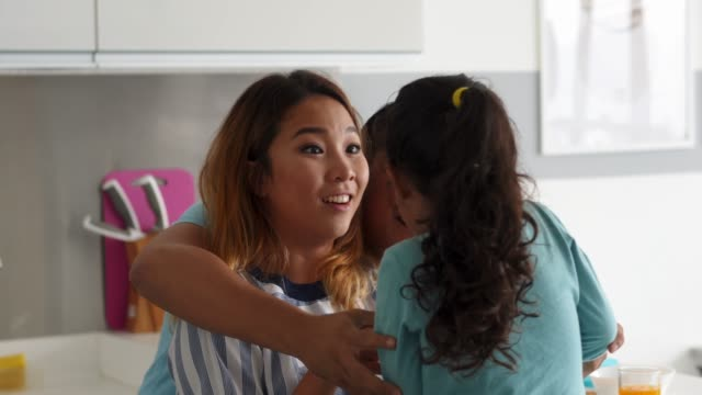 Affectionate family playing together at home video
