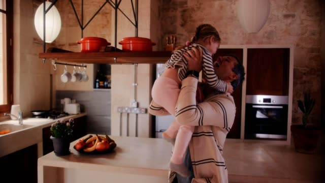 affectionate father lifting and embracing little daughter at home - fathers day stock videos and b-roll footage