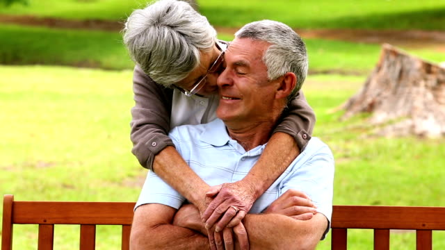Affectionate senior couple in the park video