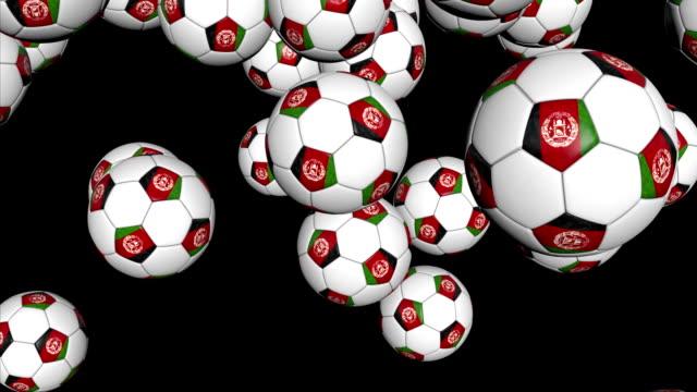 vídeos de stock, filmes e b-roll de afeganistão bolas de futebol, caindo no preto - campeonato esportivo