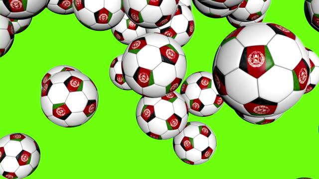 vídeos de stock, filmes e b-roll de afeganistão bolas de futebol, caindo sobre fundo verde - campeonato esportivo