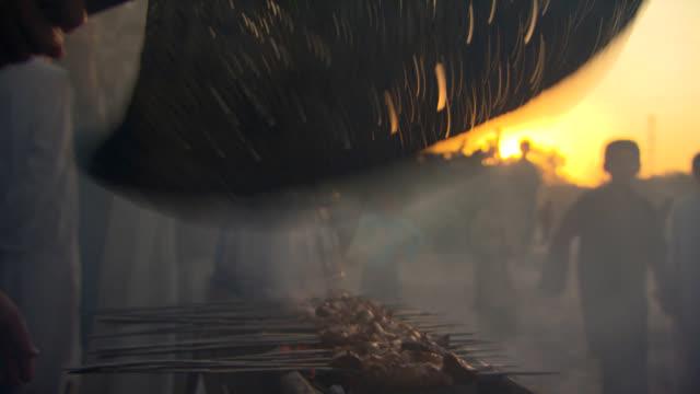 Afghanistan streetlife. Cooking kebab. video