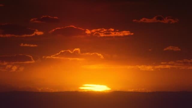 Africa. African timelapse sunrise. Sun inferior mirage.