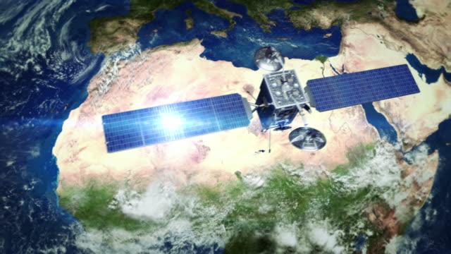 Africa. Telecommunication satellite orbiting Earth. video