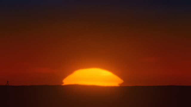 Africa. Timelapse african sunrise with big sun and inferior mirage video