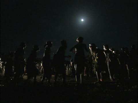 Africa, women dancing in the moonlight. video