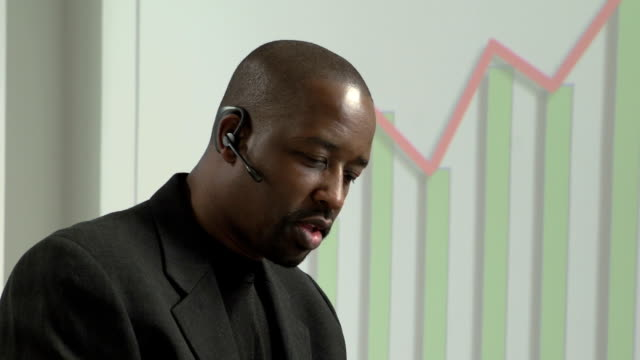 African American business man talking on his bluetooth video