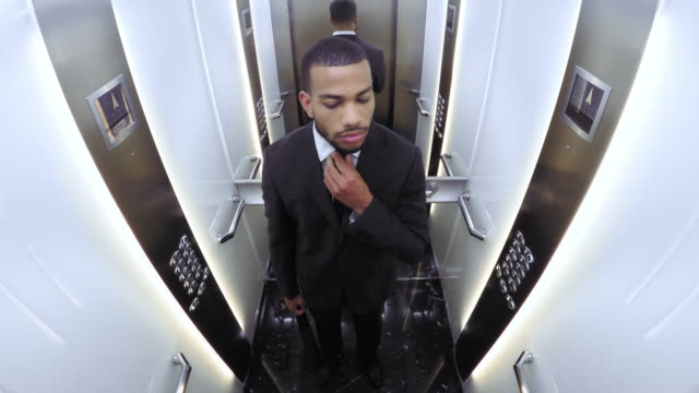 POV African American businessman in the elevator video