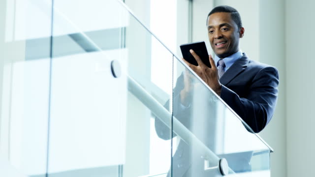 african american businessman using wireless tablet in office - professione finanziaria video stock e b–roll