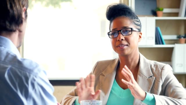 African American businesswoman talks with client in the office video
