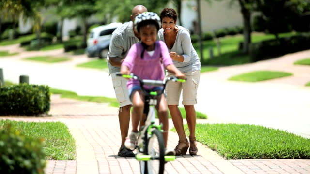African American Child Practicing on her Bicycle video