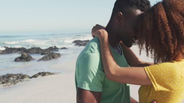 African American couple dancing seaside