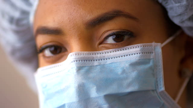 African American doctor in surgical mask video