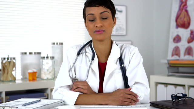 African American doctor talking to camera video