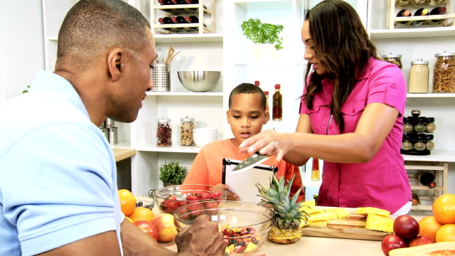 African American Family Kitchen Tablet Fresh Fruit video