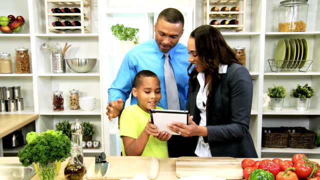 African American Family Kitchen Tablet Fresh Vegetables video