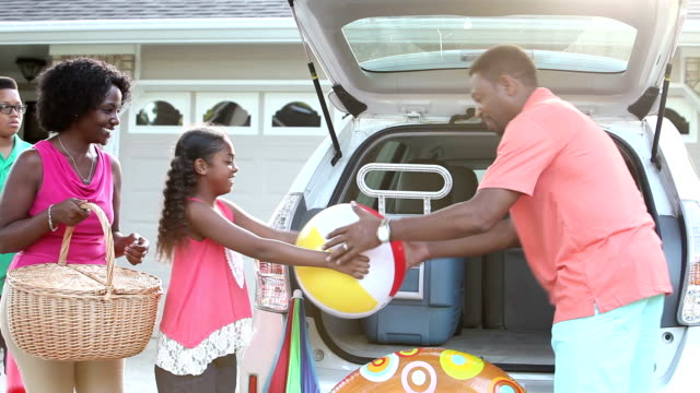 African American family packing car for trip to beach video