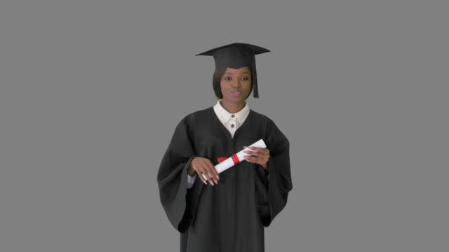 African American female graduate holding diploma and giving speech, Alpha Channel