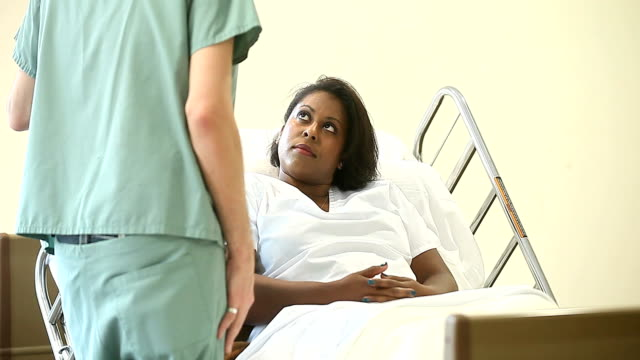 African American Female Patient in a Hospital Bed video
